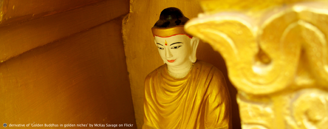 Golden Buddhas in golden niches